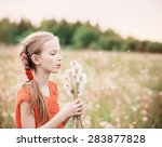 beautiful girl with dandelions | Shutterstock . vector #283877828