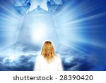 woman in front of a gate in the sky - stock photo