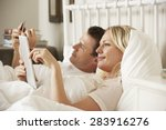 couple using digital tablet and ... | Shutterstock . vector #283916276