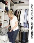 teenage girl choosing clothes... | Shutterstock . vector #283916390