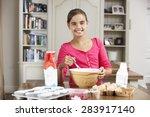 girl preparing ingredients to... | Shutterstock . vector #283917140
