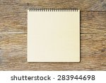 notebook  on wooden table | Shutterstock . vector #283944698