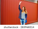 cheerful young girl stands in... | Shutterstock . vector #283968314