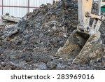Excavator Scoop Digging On The...