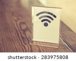 free wifi sign on table  ... | Shutterstock . vector #283975808