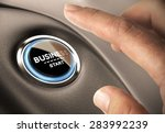 Finger pressing business button. Blue and black tones. Start up concept. - stock photo