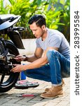 asian man doing motorcycle... | Shutterstock . vector #283995584