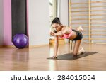 young woman performing yoga... | Shutterstock . vector #284015054