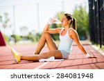 sporty young woman drinking... | Shutterstock . vector #284081948
