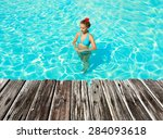 girl in resort swimming pool | Shutterstock . vector #284093618