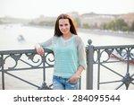 attractive brunette on bridge. | Shutterstock . vector #284095544