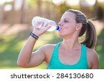 fit female athlete drinking... | Shutterstock . vector #284130680