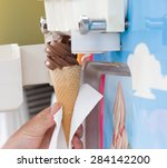 human hand holding cone with... | Shutterstock . vector #284142200