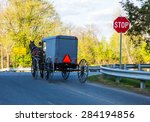 Amish Buggy Traveling Up A Roa...