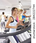 woman on running machine in gym | Shutterstock . vector #284222744