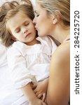 mother and daughter sleeping in ... | Shutterstock . vector #284225720