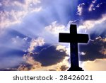 Religious Christian cross over beautiful sky with rays of light - stock photo