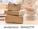 woman gives parcel in post... | Shutterstock . vector #284262770