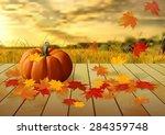 Pumpkins And Autumn Leaves On...