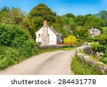 Cottages On A Country Lane At...