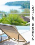 white beach chairs by the pool  ... | Shutterstock . vector #284432264