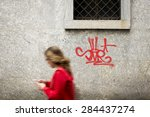 Small photo of TURIN, ITALY - MAY 29, 2015: red graffiti over the Piazza CLN's granite wall