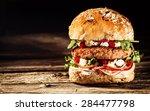 close up of burger piled high...   Shutterstock . vector #284477798