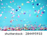 Colored Confetti Flying On Blu...