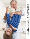 grandfather holding grandson... | Shutterstock . vector #284497886