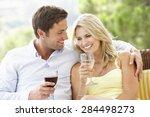 couple sitting on outdoor seat... | Shutterstock . vector #284498273