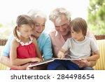 grandparents and grandchildren... | Shutterstock . vector #284498654
