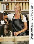 woman making coffee in shop | Shutterstock . vector #284499104