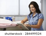 female doctor in surgery using... | Shutterstock . vector #284499524