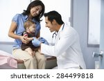 Small photo of Doctor In Surgery Examining Baby Girl