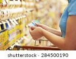 Woman in grocery aisle of...