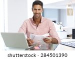 man working at laptop in home... | Shutterstock . vector #284501390