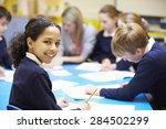 portrait of pupil in classroom... | Shutterstock . vector #284502299