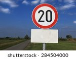 Small photo of Twenty miles per hour speed limit sign against a partly cloudy sky