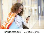 Woman In Shopping Mall Using...