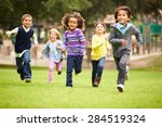 Group Of Young Children Runnin...