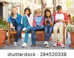 group of children sitting in... | Shutterstock . vector #284520338