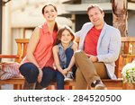 young family sitting on seat in ... | Shutterstock . vector #284520500