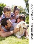 family relaxing in garden with...   Shutterstock . vector #284520770