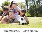 family playing football in... | Shutterstock . vector #284520896
