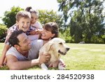 family relaxing in garden with... | Shutterstock . vector #284520938