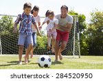 family playing football in... | Shutterstock . vector #284520950