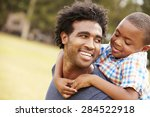 father giving son piggyback... | Shutterstock . vector #284522918