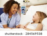 nurse sitting by young girl's... | Shutterstock . vector #284569538