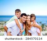 adults  back  beach. | Shutterstock . vector #284570114