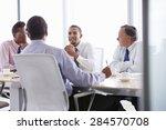 four businessmen having meeting ... | Shutterstock . vector #284570708